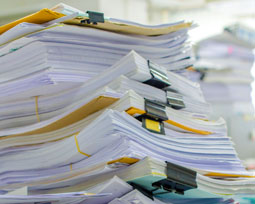 piles of documents and papers waiting to be shredded